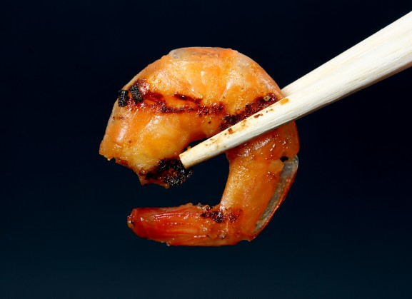 king tiger prawn shrimp isolated on dark background